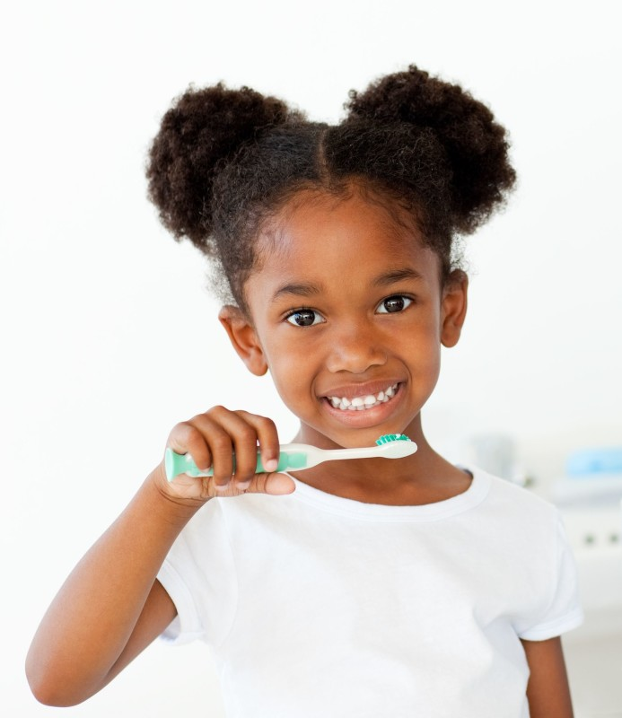 10221855 - portrait of an afro-american girl brushing her teeth