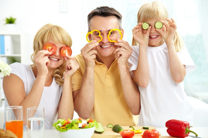 12380980 - cheerful family playing with vegetables in kitchen, healthy food