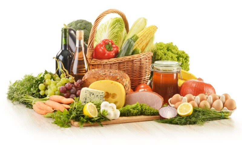 15375755 - composition with groceries in wicker basket on kitchen table