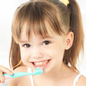 30512481 - dental hygiene. happy little girl brushing her teeth