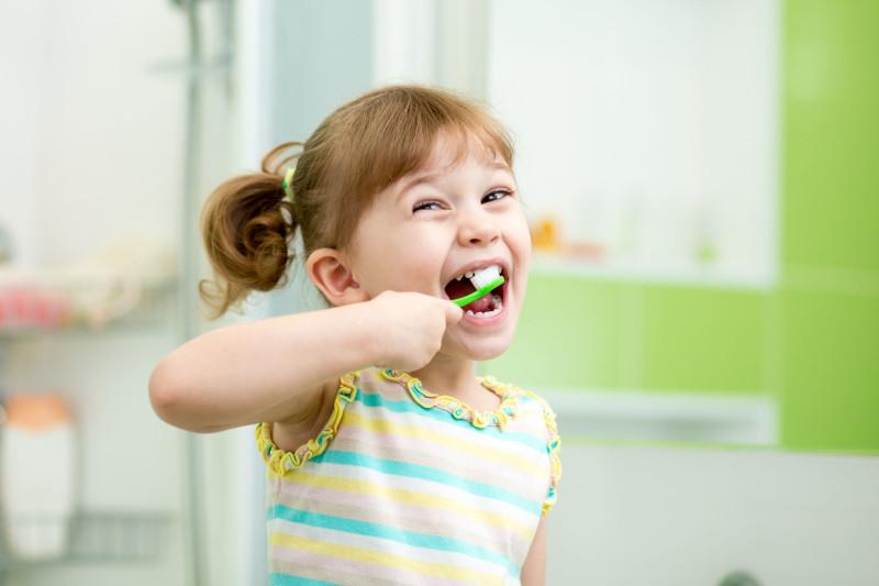 33255497 - funny child girl brushing teeth in bathroom