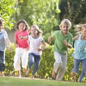 3487933 - five young friends running outdoors smiling