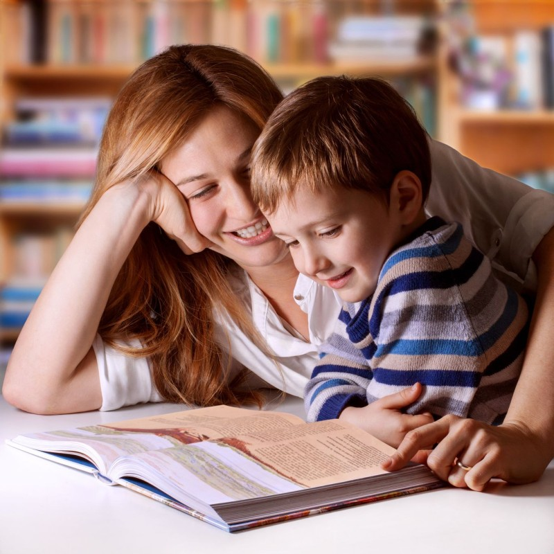 38415849 - mother reading bible stories to her boy