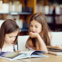 40883637 - little girls reading books in library