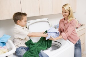 4444955 - mother and son doing laundry