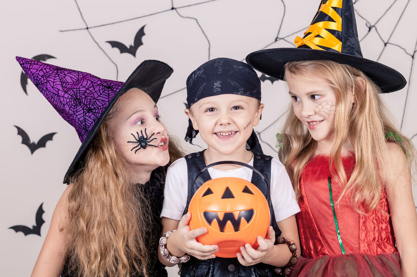 45244393 - happy brother and two sisters on halloween party