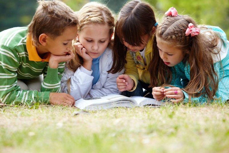 7873730 - portrait of cute kids reading book in natural environment together