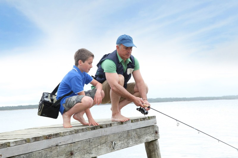 9479165 - father and son fishing in lake